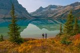 Two Men Stand by a Lake Reflecting Portal Peak Photographic Print by Gordon Wiltsie