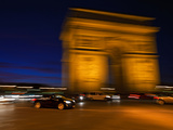 Traffic Whizzing Past the Arc De Triomphe at Night Photographic Print by Babak Tafreshi