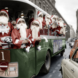 100 Santa Claus in a Special Bus in Paris December, 19, 1966. Colorized Document Photo