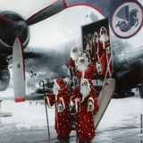 Ten Santa Claus Deplaning December 15, 1953. Colorized Document Photo