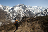A Trekker Looks Out at the View of Ganesh Himal Mountains in Nepal Photographic Print by Alex Treadway