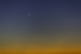 The Rising New Moon at Sunset Photographic Print by Jonathan Irish