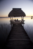 People Relaxing at Sunset, Lago Peten Itza, El Remate, Guatemala, Central America Photographic Print by Colin Brynn