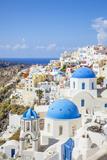Greek Church with Three Blue Domes in the Village of Oia Fotografie-Druck von Neale Clark