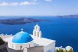Blue Dome and Bell Tower Above Aegean Sea Photographic Print by Neale Clark