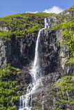 Ice Melt Waterfall on the Olden River as it Flows Along Briksdalen Photographic Print by Michael Nolan