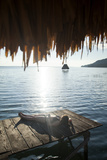Woman Relaxing on Dock, El Remate, Lago Peten Itza, Guatemala, Central America Photographic Print by Colin Brynn