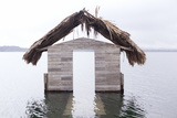 High Water Floods Lakeside Cabanas, Climate Change, Lago Peten Itza, Guatemala, Central America Photographic Print by Colin Brynn