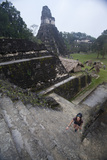 Woman Climbing Stairs at Mayan Archaeological Site, Tikalguatemala, Central America Photographic Print by Colin Brynn