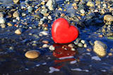 Red Valentine Heart on the Beach Photographic Print by  Hannamariah