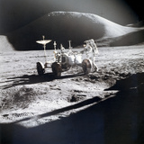 James B. Irwin Works at the Lunar Roving Vehicle Reproduction photographique