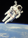 Astronaut in Space Suit Floating in Space Photographic Print