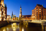 Warehouse District ( Speicherstadt ) of Hamburg at Night with View towards the City Center Includin Photographic Print by Inga Nielsen