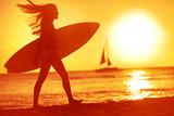 Surfing Surfer Woman Babe Beach Fun at Sunset. Girl Walking in Sunshine in Warm Evening Sun Holding Photographic Print by  Maridav