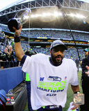 Russell Wilson with the NFC Championship Trophy 2014 NFC Championship Game Photo
