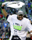 Russell Wilson celebrates winning the 2014 NFC Championship Game Photo
