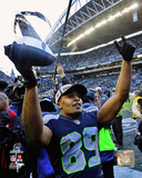 Doug Baldwin with the NFC Championship Trophy 2014 NFC Championship Game Photo