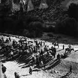 A Tourist Group Arriving on Mules to around the Burried City of Kaymakli, Turkey Photographic Print by Pietro Ronchetti