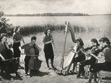 Young Musicians at a Concert on the Banks of a Lake Photographic Print by Luigi Leoni