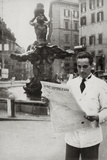 A Man Reads the Newspaper the Republican Voice in Front of the Fountain of the Triton Photographic Print by Luigi Leoni