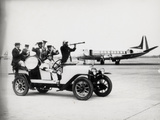 A Vintage Car with a Welcoming Band at the Airport Photographic Print by Luigi Leoni