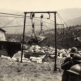 The Transport of a Wounded Prisoner by Way of a Mechanical Lift in the Asiago Plateau Photographic Print by Carlo Baravalle