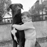 A Child with dog Affiches