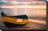 Old Boat at Sunset Beach Stretched Canvas Print