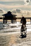 Cyclist on a Florida Beach at Sunset Lámina fotográfica por Philippe Hugonnard