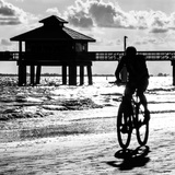 Cyclist on a Florida Beach at Sunset Fotografisk tryk af Philippe Hugonnard