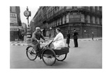 Carrier Bicyclist in Paris, 1940 Photographic Print by  Scherl