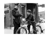 Policeman Controls a Cyclist in America, 1938 Photographic Print by  Scherl