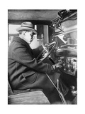 Man Sitting Inside of a Chevrolet Sedan, 1925 Photographic Print by  Scherl