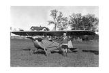 Frau neben einem Kleinflugzeug, 1927 Photographic Print by  Scherl