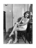 Woman Putting on Stockings, 1933 Photographic Print by  Scherl
