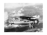 Airplane of Transcontinental and Western Airlines in Flight, 1932 Photographic Print by  Scherl