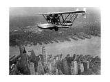 Amphibian Flying over New York City, 1932 Photographic Print by  Scherl