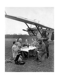 Air Travelers During a Break Next to an Airplane, 1930 Photographic Print by  Scherl