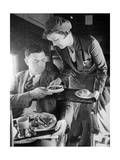 Stewardess Serving Dinner Aboard an Airplane, 1932 Photographic Print by  Scherl