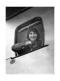 Junge Frau blickt aus dem Kabinenfenster eines Flugzeuges, 1929 Photographic Print by  Scherl