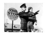 Verkehrspolizist mit Kind in Kansas City, 1938 Photographic Print by  Süddeutsche Zeitung Photo