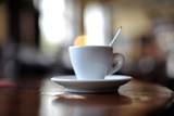 A Cup of Coffee Standing on the Table in a Restaurant Photo by Frank May