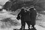 Wounded Soviet (Russian) Soldier Helped by Two Comrades in a Street Filled with Rubble, Vienna Photo by Evgenii Khaldei
