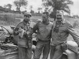 Robert Capa (Left) and Ernest Hemingway (Right) with their Driver U.S. Army Driver Photo