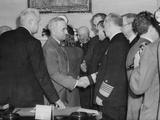 A Solemn Harry Truman Shakes Hands with Admiral William Leahy after Being Sworn in as President Photo
