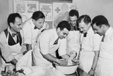 Expectant Fathers Bathing a Doll During an Infant Care Class at the Brooklyn Red Cross Headquarters Photo