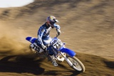 Motocross Racer on Dirt Track Photo