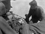 Wounded, But Alert, U.S. Soldier in an Outboard Stretcher-Basket Attached to Rescue Helicopter Photo