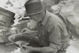Man Panning Gold at Pinos Altos, New Mexico Print by Russell Lee