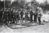 Reverent German Soldiers Stand with Shovels at the Grave of the Commanding Officer Posters